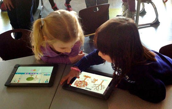 Kids using Scratch, Jr. app