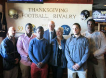 football captains, coach, school superintendent, and mayor